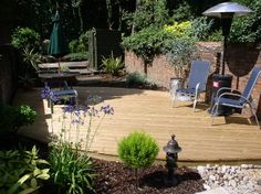 Softwood decking and agapanthus. Garden Wall Planter, Planters, Small Garden Inspiration, Garden Ideas, Hardwood Decking, Agapanthus, Exeter, Devon, Garden Design