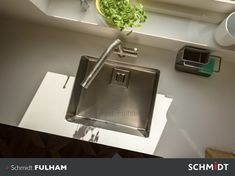 A sunken sink adds to the flush lines of this kitchen.