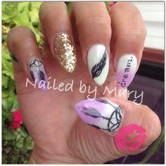 Dream catchers stiletto almond nails.