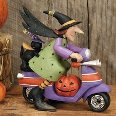 Witch and Black Cat Riding on a Scooter Halloween Figurine. Scooty-Boo!