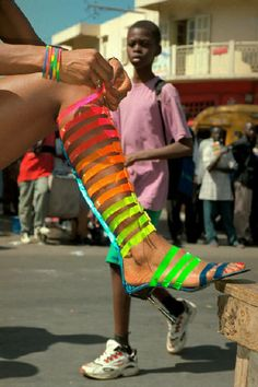 I love this photo of the women putting her shoes on as it showes her creative love of vibrant neon colours.