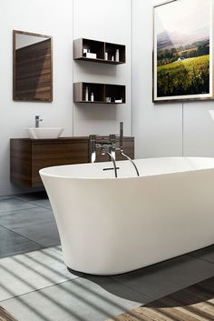 The smooth, curvaceous lines of a modern freestanding bath provide understated luxury to contemporary bathrooms.