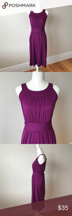 Banana Republic Jersey Halter Dress Soft Jersey cotton in a beautiful eggplant color with a touch of sheen. Pretty halter neckline, built-in waist tie. Falls to mid shin. Machine wash flat dry. Great condition. Banana Republic Dresses Midi