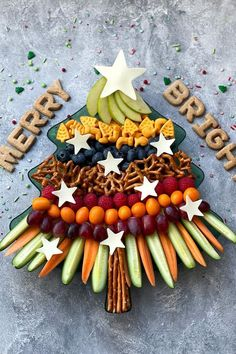 This veggie tray is anything but boring! Pile this Christmas tree-shaped tray with cut vegetables, fruit, and crackers. It's perfect for munching on as you settle in for a holiday movie marathon. #healthychristmassnacks #christmassnacks #healthychristmastreats #holidaysnacksforkids #bhg Healthy Christmas Treats, Veggie Christmas, Christmas Apps, Holiday Snacks, Christmas Snacks, Holiday Cakes, Christmas Countdown, Christmas Cookies, Holiday Recipes