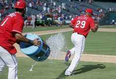 Texas Rangers shortstop Elvis Andrus (1) attempts to douse third baseman Adrian Beltre (29) after a win over the Boston Red Sox in a baseball game Sunday, June 26, 2016, in Arlington, Texas. (AP Photo/Brandon Wade)