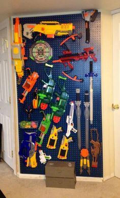 Using inspiration from a 'stash vault' pin, which is now a dead link, this is the nerf weapon storage solution I came up with using painted pegboard and pegs.