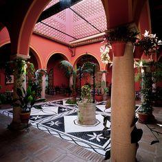 Pretty courtyard with beautiful tile work at Parador de Arcos de la Frontera in Andalusia, Sapin
