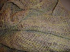 Check this out at https://www.etsy.com/shop/JoyfulNoiseWeaving This beautiful, hand woven scarf has subtle but beautiful colors running through out the yarn. It was woven from a fabulous Blue Heron yarn called, flax. When the light hits this scarf you can see shades of green, sometimes silver, sometimes lilac...it has amazing colors. This hand woven scarf would be beautiful on a simple black dress or blouse or try it with a casual outfit to give it a touch of class.