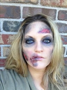 Halloween Zombie Makeup  Easy DIY and probably already in your makeup bag. I did my makeup as I usually would with the exception of using his a very light foundation and sheer powder.  Then I added lots of sheer black eyeshadow around the eyes.  I dabbed pink/red lipgloss on spots around my face and then topped that with more of the eyeshadow to give it a dirty wound effect.  I used a blue eyeliner pencil to add lots of veins around the eyes and on the dark spots  And Voila!!