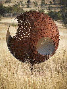 1.8m tall, stainless/corten steel (side 2 - grape leaf)
