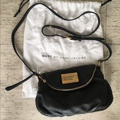 Marc By Marc Jacobs Classic Q Natasha Mini Black leather cross body bag with zipper pocket. Gold details comes with original duster bag. Marc by Marc Jacobs Bags Crossbody Bags