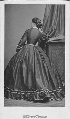 Pauline Metternich models a later model crinoline day dress, evidenced by the close sleeves.