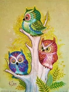 Three little owls sitting in a tree..