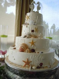 Awesome beach wedding cake! with cute seahorses :)
