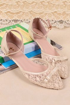 Sandals crafted in PU, featuring low vamp, pointed toe, bow-knot to front, mesh design, ankle strap with pin buckle fastening.$58