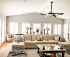 Beautiful living room with Softedge shutters all around including on the doors. Our patentend Softedge shutters are mounted onto the trim. The edges are rounded so the look like they are a part of the home. The hinges are concealed and allow you to keep the tilt-in feature without a box protruding from the window! Call us if you are interested in an in-home sonsultation! Cafe Shutters, Traditional Shutters, Beautiful Living Rooms, Tilt, Hardwood, Couch, Windows, Doors, Warm
