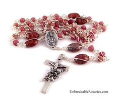 Sacred Heart of Jesus Immaculate Heart of Mary rosary beads in pink rhodonite. www.UnbreakableRosaries.com