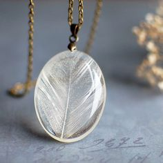 Feather resin pendant natural white real feather by Goodthings88 Hannah Marcotti