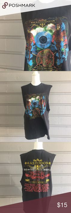 Mastodon tour shirt cut off sleeves Hi Y'all! All items in my closet are sold as is, any flaws that I find while I do my inspection will be displayed in the photographs or notes below. Measurements are available on request, and I'm happy to answer any questions you might have, or post additional photos. If you're concerned about fit or anything else please, please, please ask before purchasing! Items come from a smoke free home with one big fur baby, I launder all clothing before posting…