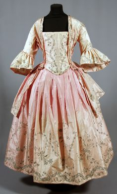 Swedish  c1774 Probably a wedding gown. The dress is made up of silk with silver embroidery, width at the bottom 300 cm, length 460 mm. For back, see other pin.