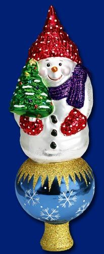 Do you top your Christmas tree with an Old World Christmas Tree Top? Standing 10 inches tall, the Snowman Tree Top is the perfect final touch to a Christmas tree! #christmastree #treetoppers #oldworldchristmas #snowman Visit our website to see all the tree toppers we offer www.oldworldchristmas.com