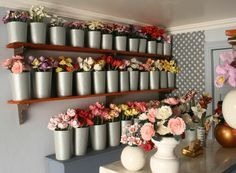 Use dollar store wastebaskets to create a life sized floral storage area