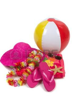 Colorful summer beachwear, flipflops, hat, orchids, sunglasses, beach ball and starfish photo