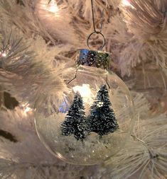 Turn clear Christmas ornaments into a snowglobe with a winter scene inside