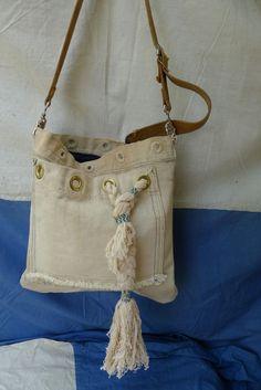 shoulder bag. vintage sailors hammock, vintage leather belt, old denim, woven rope bangle on front.