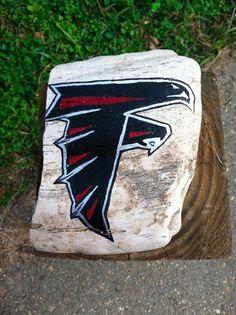 Hand Painted Atlanta Falcons logo on Mississippi Petrified Wood.       #artsandcrafts #petrifiedwood #fossil #rock #minerals #handpainted #originalart #nature #decor #naturedecor #crafts #art #Falcons #NFL #football #AtlantaFalcons