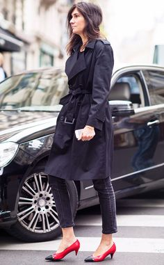 Black trench coat, black cropped jeans, and red and black kitten heels
