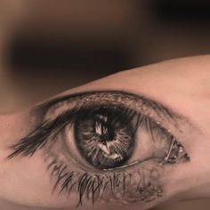 Perfect piece by Niki Norberg... His portfolio includes many stunning realistic eye tattoos, check it!