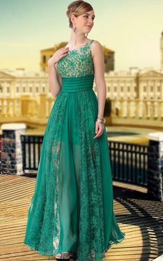 Trendy green evening dress featuring sleeveless A Line silhouette, mini skirt with floor length chiffon overlay with matching laces on bodice, boat neckline, an