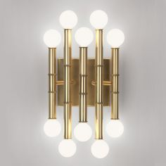 Meurice 5 Arm Wall Light, by Jonathan Adler, comes with a Polished Nickel, Deep Patina Bronze, or Antique Brass finish. Ten 25 watt, 120 volt G16.5 type Candelabra base incandescent bulbs are required, but not included. UL listed. 7.75 inch width x 12 inch height x 5.5 inch depth.