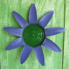 Tin can flowers.  Easily hung, inside or out, for a splash of color.  About 16-inches wide.