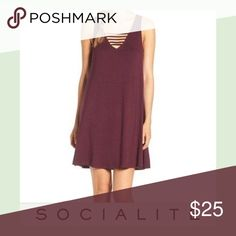 NWT Socialite Strappy tank dress Eggplant This is brand new with tags. So cute! It has the strap going across the front and back. Would be so adorable with leggings, boots, and a long cardigan for fall! 😻 Dresses