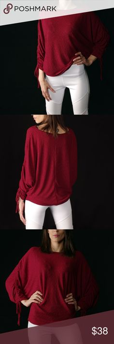 """Just In! Ruby Red Dolman Sleeve Knit Top Just In!! Pictures are of actual product and my own. Please do not use without asking.  3/4 Sleeve top with ruched string detail on sleeves. FABRIC CONTENT:  53% Polyester, 43% Rayon, 4% Spandex MODEL MEASUREMENTS:  - Model is 5`7 wearing a Small (Young Contemporary)  - Bust: 30""""  - Waist: 24""""  - Hips: 34"""" USA Pearl & Berry Tops Tunics"""