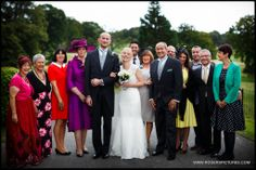Group and formal family photo at Denton Hall in Yorkshire by Wedding Photographer Paul Rogers