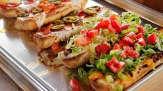Get French Bread Pizzas Recipe from Food Network