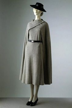 Day dress and cape Place of origin: Paris, France (made) Date:1933 (designed) Artist/Maker: Madeleine Vionnet, born 1876 - died 1975 (designer) Materials and Techniques: Woollen jersey, chrome, leather