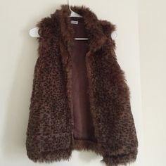 Faux Fur Leopard Vest Worn once soft and pretty faux fur vest with one clip in the front for closure Charming Charlie Jackets & Coats Vests