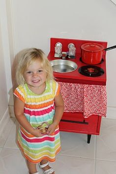 I like the sink (I think it is a cake pan) and are those old records for the burners?