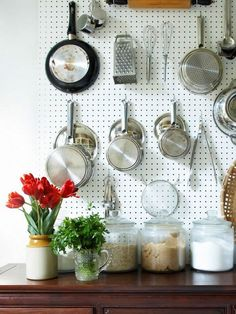 LOVE how this saves space in drawers by putting kitchen utensils on the wall!