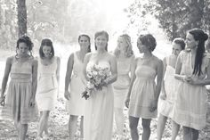 Casual country wedding - are those the bridesmaids - dresses are gorgeous and perfect...love the difference in each!