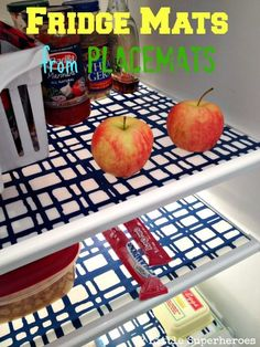 Organize Your Kitchen (On a Budget!) • Great inexpensive kitchen organizing ideas, including this idea for using dollar store vinyl place mats as fridge mats from '2 Little Superheroes'!