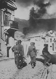 Group of German soldiers walking down a street in Yalta, Crimea.