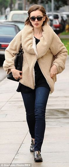 Funky: The 25-year-old actress kept warm in a quirky textured jacket on her casual day out...
