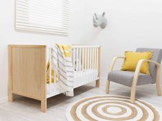 Mocka Aspiring Cot - White/Natural with Britta Chair, Circa Rug and Animal Heads