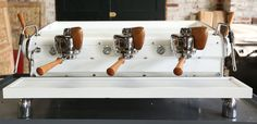 Legendary espresso machine-maker Slayer collaborates with Ninety Plus on a custom three-group machine