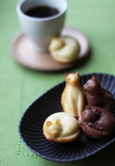 Madeleines by chick*pea, via Flickr. According to the comments, they were made with a special pan found at Muji in Japan.